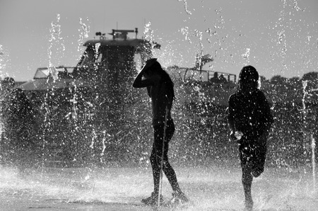 Girls playing in the water B & W