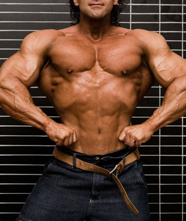 Bodybuilder in front of wall Stock Photo - 409484