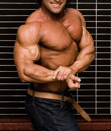 Bodybuilder in front of wall Stock Photo - 409473