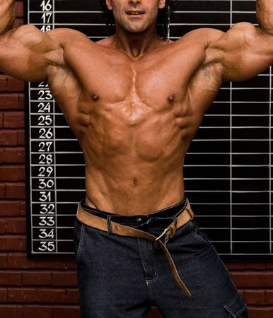 Bodybuilder in front of wall Stock Photo - 409474