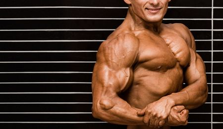Bodybuilder in front of wall Stock Photo - 409460