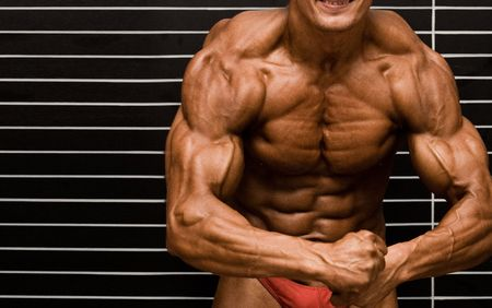 Bodybuilder in front of wall Stock Photo - 409459
