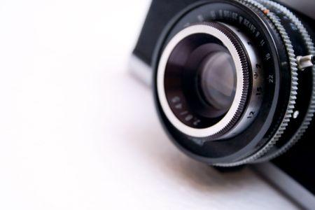 postwar: Vintage camera lens isolated on white background - shallow DOF Stock Photo