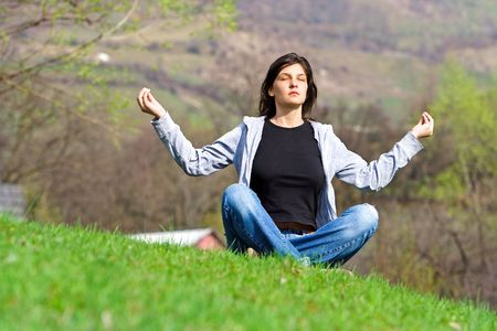 Young woman meditating Stock Photo - 416797