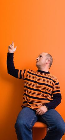 Man pointing something over his head - copyspace photo