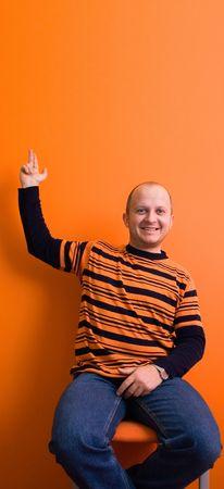 Man pointing upwards - copyscpace photo