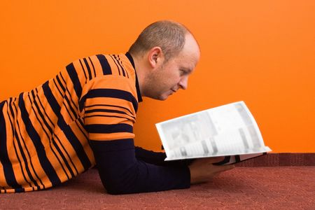 Casual man reading a magazine - pages are blured you can put anything you want in place Stock Photo - 416320