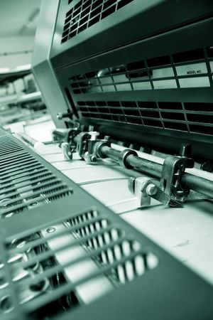 impress: Closeup of an Offset Printing Machine in print shop Stock Photo