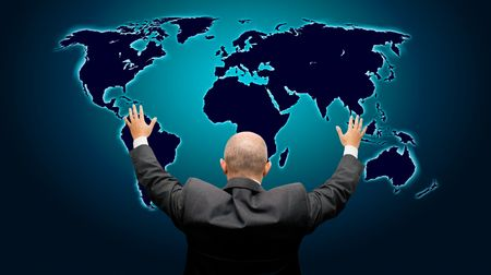 Business man with hands in the air in front of a blue glowing world map - high details photo