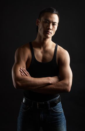 Great looking asian guy shot in studio - tough pose