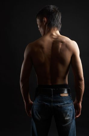 Great looking asian guy shot in studio - back pose