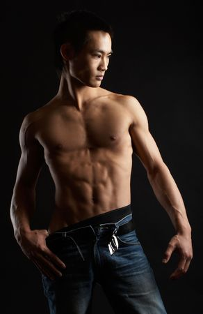 asian abs: Great looking asian guy shot in studio - artistic pose
