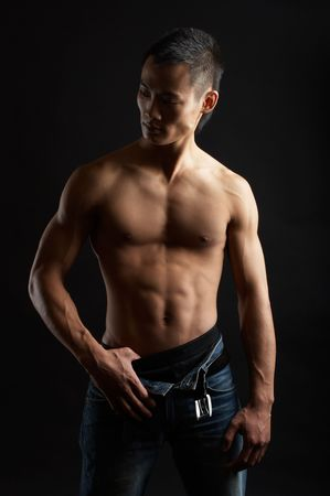 tough: Great looking asian guy shot in studio - artistic pose