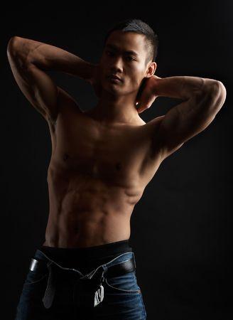 Great looking asian guy shot in studio - artistic pose