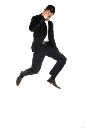 Great looking asian businessman shot in studio - jumping photo