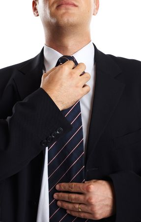 Young Modern Businessman Closeup adjusting his tie Stock Photo - 701237