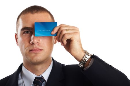 Young Modern Businessman portrait with credit card in front of his face Stock Photo - 701233