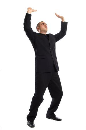 Young Modern Businessman portrait shot in studio over white background - pushing something upwards Stock Photo - 701218