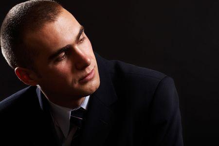 Young Modern Businessman portrait shot in studio over black background Stock Photo - 701108
