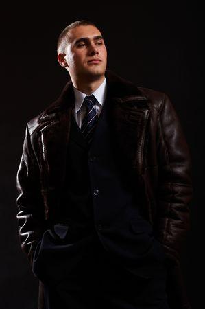 Young Modern Businessman portrait shot in studio over black background Stock Photo - 701037