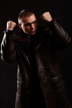 Young Modern Businessman portrait shot in studio over black background Stock Photo - 701033