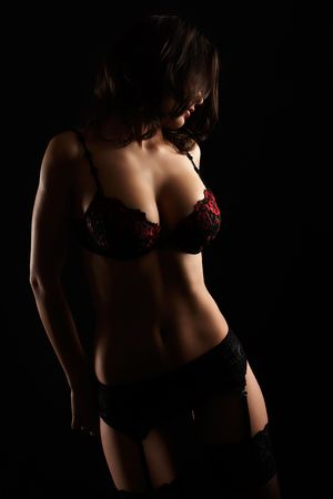 Sexy lingerie model posing in the studio Stock Photo