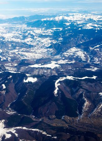 holidays vacancy: Aerial view from airplane above Romania - the carpathians mountains