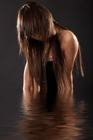 Woman emerging from water Stock Photo - 793205