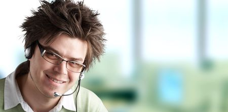 handsom: Attractive Customer Representative with headset smiling during a telephone conversation Stock Photo