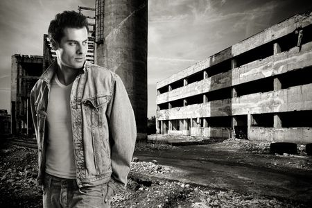 Handsome fashion model shot at an old romanian abandoned factory Stock Photo - 1149396