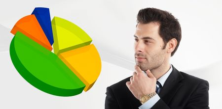 Handsome Businessman shot in studio isolated on white watching a pie-chart - check my portfolio for similar photos Stock Photo - 1149397