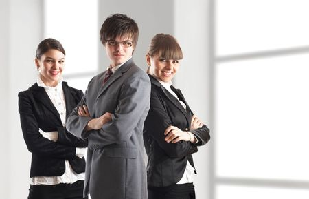 Young attractive business people - businessman and 2 businesswoman Stock Photo - 1149411