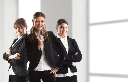 Young attractive business people - three young businesswoman Stock Photo - 1149412