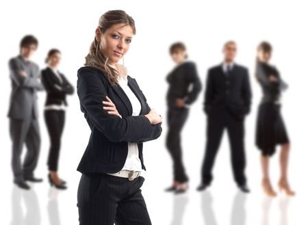 elite: The Businesswoman - elite dream team - people in the background are out of focus Stock Photo
