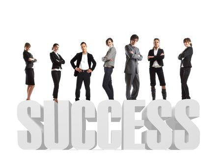 Young attractive business people - the elite business team - on 3d text success Stock Photo