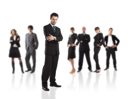 Serious Businessman - elite dream team - people in the background are out of focus Stock Photo
