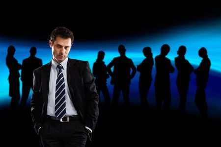 Team Leader with silhouettes behind him - check my gallery for more business photos Stock Photo - 1186306