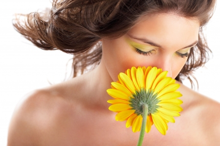 Beautiful angelic woman smelling a flower - check out my portfolio for more pictures Stock Photo