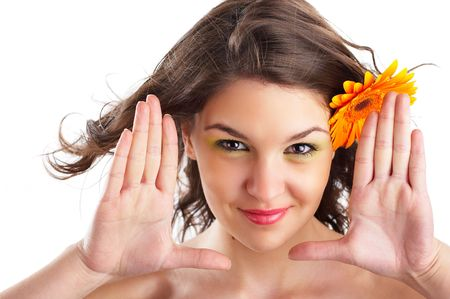 Beautiful angelic woman with flower in her hair framing her face Stock Photo - 1186193