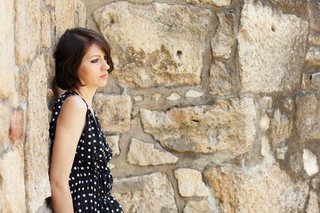 Fashion model - leaning on ancient wall - check my portfolio for more pictures Stock Photo - 1186206