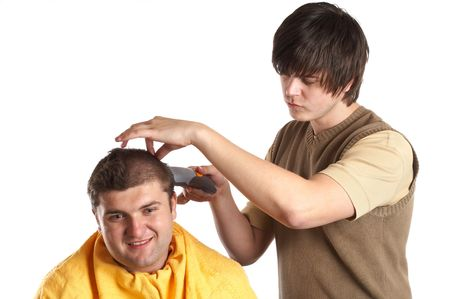 Handsome man getting a haircut - isolated white background Stock Photo - 1186129