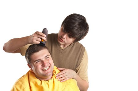 Handsome man getting a haircut - isolated white background Stock Photo - 1186130
