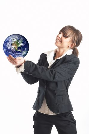 online internet presence: Young attractive businesswoman holding the Earth in her palms