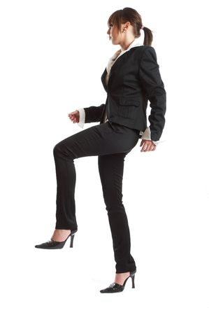 Young attractive business woman steping on imaginary step Stock Photo - 1186141