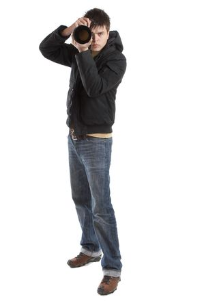 Attractive photographer with big zoom lens over white background - paparazzi photo
