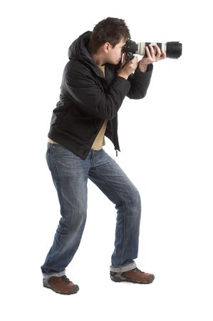 photography session: Attractive photographer with big zoom lens over white background - paparazzi