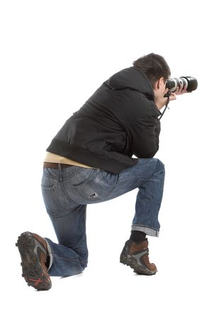 wedding photography: Attractive photographer with big zoom lens over white background - paparazzi