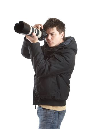 Attractive photographer with big zoom lens over white background - paparazzi Stock Photo - 1186108