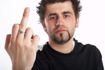 arrogancia: Angry Young modelo masculino m�s de fondo blanco  Foto de archivo