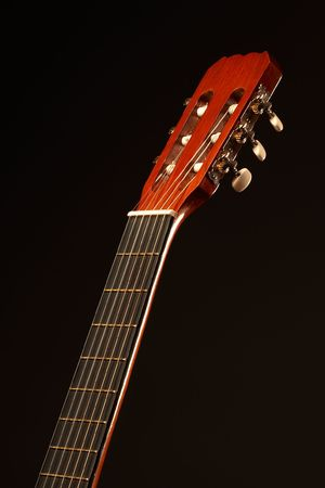 re do: Acoustic guitar over black background - the neck
